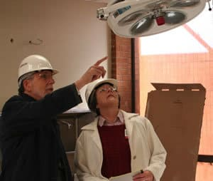 CHRP Dean Ronald Winters and Associate Dean Diane Skinner check out the new home of the surgical technology program.