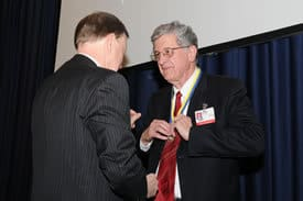 Joel Anderson, president of The Rotary Club of Little Rock, presents I. Dodd Wilson, UAMS Chancellor, with the Business and Professional Leader of the Year award.