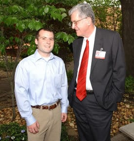 UAMS Chancellor I. Dodd Wilson, M.D., visits with College of Medicine senior and Ilse F. Oates scholarship recipient James Gregory.