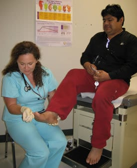 Renee Walls-Caldwell, Advance Nurse Practitioner, conducts a foot exam in the DeQueen clinic where diabetes management is a major emphasis