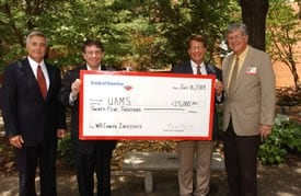 Celebrating the Bank of America donation are (from left) UAMS' John Blohm, Donnie Cook of Bank of America, and UAMS' Peter D. Emanuel, M.D., and Chancellor I. Dodd Wilson.