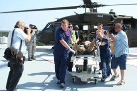 UAMS emergency staff Daniel Eubanks and Lauren Smith (left), and Brandy Cornwell and Joe Fendley (right), take a patient to triage during the Aug. 2 exercise.