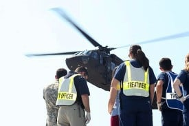 UAMS emergency staff wait for a Blackhawk helicopter to land during the mass casualty exercise.