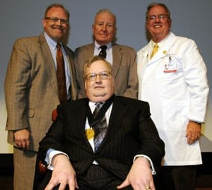 Dr. John Cone (seated) was honored by colleagues (left to right) Drs. Ronald Robertson, Gilbert Campbell and Kent Westbrook.