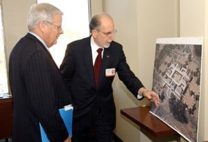 CHRP Dean Ronald Winters shows UA System President Alan Sugg an aerial view of the college's new home.