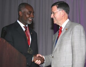 UAMS' Richard McCarthy, M.D., (right) recently became president of the Scoliosis Research Society, taking over for Oheneba Boachie-Adjei, M.D.
