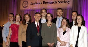 Richard McCarthy, M.D., poses with his family after becoming president of the international Scoliosis Research Society.