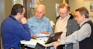 Bart Barlogie, M.D., Ph.D., (second from left) confers with UAMS colleagues (from left) Elias Kiwan, M.D.; Frits van Rhee, M.D., Ph..D.; and Elias Anaissie, M.D.