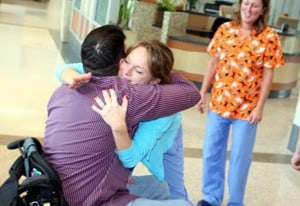 Several of the UAMS medical experts who treated Brent Adams welcomed him back.