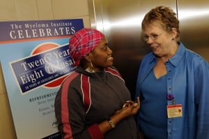 Eleven-year myeloma survivor Evalean Fuller of Birmingham, Ala., visits with Bonnie Jenkins, R.N., Myeloma Institute director of program coordination, during the reception celebrating the institute's 20th anniversary.