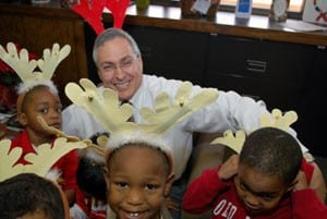 UAMS Chancellor Dan Rahn is surrounded by a herd of Head Start reindeer.