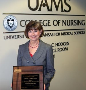 Jean McSweeney, Ph.D., R.N., holds her Katharine A. Lambright Award.