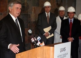 Arkansas Gov. Mike Beebe talks about a $10.5 million NIH grant to the Cancer Institute while UAMS Chancellor Dan Rahn, M.D., and Peter Emanuel M.D., look on.