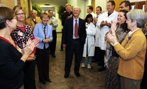 John P. Shock, M.D., steps off the elevator to the applause of more than 200 guests.