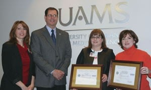 From left, Michelle Miller of UAMS, Richard Green of the Arkansas Committee for Employer Support of the Guard and Reserve, pose with new Patriot Award recipients Linda Stone and Marsha Ballard.