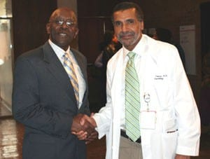 Billy Thomas, M.D., UAMS assistant vice chancellor for diversity, and Hosea Long, UAMS associate vice chancellor for human resources
