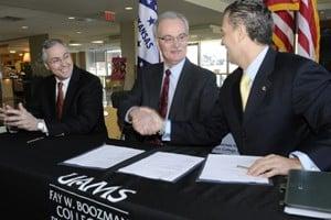 UAMS Chancellor Dan Rahn, College of Public Health Dean Jim Raczynski and Mexican Consul Andres Chao sign the memorandum of understanding.
