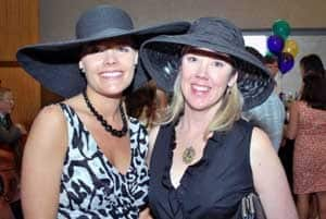 Kori Trice and Shelli Jordan donned derby hats to watch the