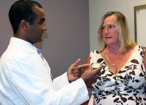 UAMS' Ayman Mahdy, M.D., and Laurene Payton discuss the implant device that was used to successfully treat Payton's incontinence.