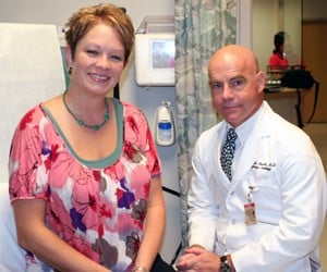 """Katrina Davis (left) said she is spreading the word among friends and coworkers about her scarless hysterectomy by UAMS' Alexander """"Sandy"""" Burnett, M.D. (right)"""