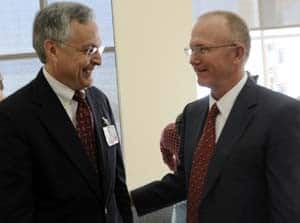 UAMS Chancellor Dan Rahn, M.D., visits with Mark White, Arkansas Blue Cross president and chief executive officer, following the grant announcement.