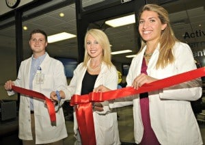 Students (from left) Ted Clowers, Andrea Coker and Rachael McCaleb cut the ribbon opening the new Active Learning Center.