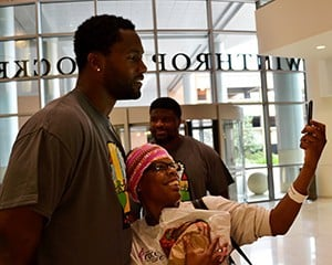 Michael Johnson poses for a selfie with Loretha Burman.