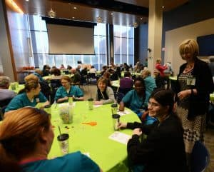Roxane Townsend, M.D., UAMS Medical Center CEO, speaks with hospital volunteers at April's luncheon.