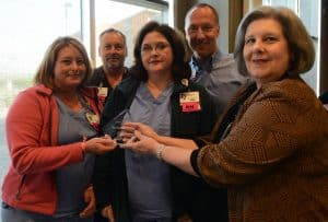 Mary Helen Forrest, UAMS chief nursing officer, presents the staff of E4 ICU with the UAMS Medical Center Volunteer Supervisor of the Year Award.
