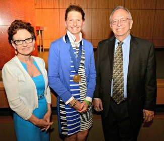 Helen Lang, R.N., (left) and Nicholas Lang, M.D., join Claudia Barone, Ed.D., A.P.R.N., for a photo.