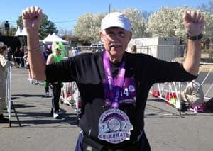 Jim Brown shows off his medal from completing the Little Rock Marathon in March, his first full marathon.