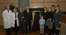Crow and Stacy Rudnicki, M.D., pose with May and members of his family.