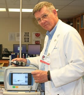 William Culp, M.D., is leading stroke research at UAMS with the EKOS machine, above, in Culp's lab.