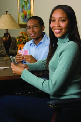 Siblings Bryan Clay and Ambra Jackson enjoy playing cards and spending time together.