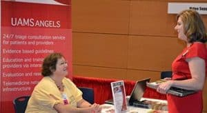 Margaret Glasgow, left, visits with Sarah Rhoads-Kinder, D.P.N., at the Telehealth Expo.