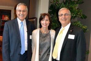 UAMS Chancellor Don Rahn, M.D., (left) visits with UAMS Foundation Fund Board member Freddie Black and his wife, Liz, who helped co-host the reception.