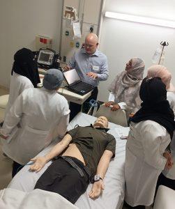 Travis Hill (center) gives technical instruction to the simulation technicians at Princess Nora Bint Abdulrahman University.