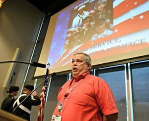 Bruce Rodtnick of UAMS Information Technology, who was a sergeant in the Air Force, sings the National Anthem during the Nov. 3 Veterans Appreciation Breakfast at UAMS.