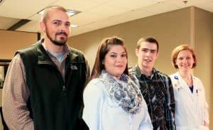 Darius Hoppis with his parents, Corey and Rena, and his surgeon Erika Petersen, M.D.