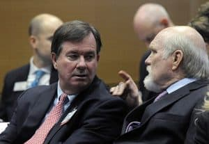 Lowry Barnes, M.D., chats with Terry Bradshaw before a UA Board of Trustees meeting on the UAMS campus.