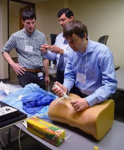 Hunter Holthoff, M.D., practices a ultrasound-guided renal biopsy on simulation technology.