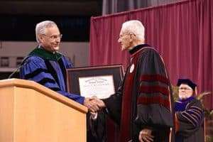 UAMS Chancellor Dan Rahn, M.D., presents the Chancellor's Award to Charles E. Scharlau III, J.D.