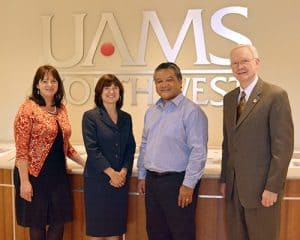 Sheldon Riklon, M.D., (second from right) is joining UAMS on Aug. 1. He is shown with Pearl McElfish, Ph.D., director of the Office of Community Health and Research; Stephanie Gardner, Pharm. D., provost; and Peter Kohler, M.D., vice chancellor of the UAMS northwest Arkansas campus.