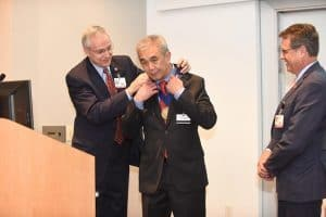 UAMS Chancellor Dan Rahn, M.D. (left) presents the chair's medallion to James Y. Suen, M.D, while UAMS Cancer Institute Director Peter Emanuel, M.D., stands nearby.