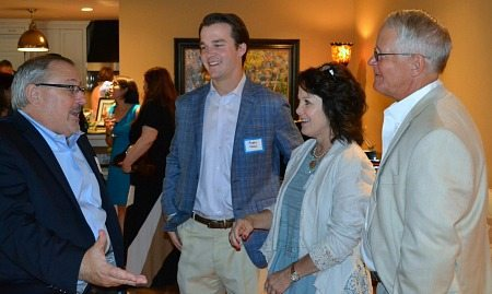 David Hunton, M.D., regales (from left) Austin, Tammy and Bennett Nolan.