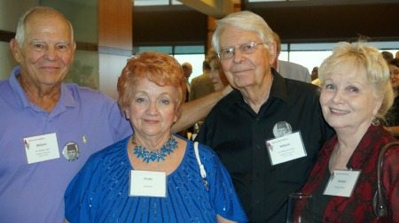 Dr. William Hall, COP '61, Phyllis Byrum, Dr. William Dorsey, COP '61, and his wife, Carolyn Dorsey, attend the Chancellor's Reception held Friday night.
