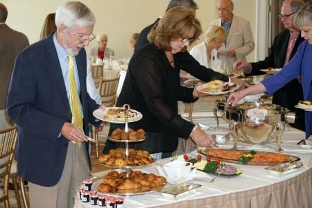 Phillip L. Smith, M.D., COM '66, and Karen Suen line up with other alumni for a sumptuous brunch buffet held at the Capital Hotel for Golden Graduates and their families.