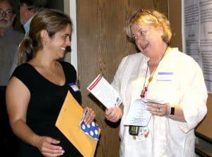 Parent gets pamphlet from program
