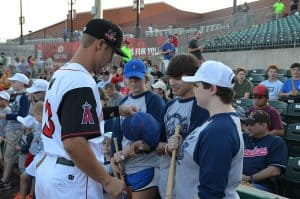 An Arkansas Travelers baseball players signs autographs for UAMS' youngest radiation oncology patients.