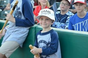 One of UAMS' youngest radiation oncology patients enjoys the ROC Star event at Dickey-Stephens Park.